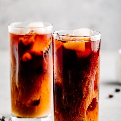 Almond milk cold brew coffee latte in tall glasses