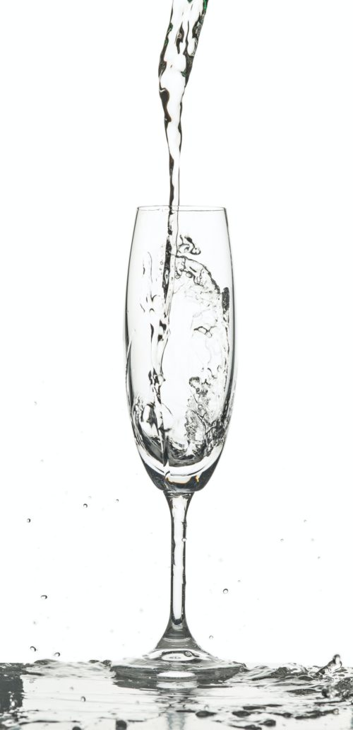 The water splashing to glass on white background